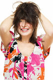 Tousled hair. Smiling young woman with tousled hair on white Royalty Free Stock Images