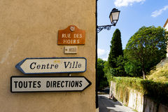 Toutes Directions and Centre Ville signs in the South of France village of Grimaud, Var, France Stock Photo