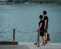 Toutists walking on riverbank in Singapore Stock Photography