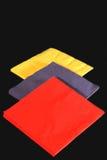 Tovaglioli colorati sul nero Fotografie Stock Libere da Diritti