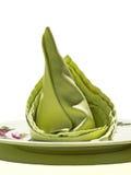 Tovagliolo verde su priorità bassa bianca Fotografia Stock