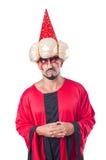 Tovenaar in rood kostuum Stock Foto's
