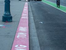 Tow away bus zone red painted curb in city royalty free stock photo