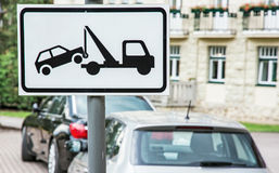 Tow away sign, no parking place. Tow away sign. No parking place. The cars are parked on prohibition parking. Traffic sign Royalty Free Stock Photo