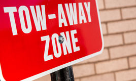 Tow away zone. Red sign warns of tow zone. Do not park here or your vehicle will be towed royalty free stock images