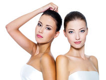 Tow beautiful sexy women. Portrait of a two beautiful sexy young women - Isolated on white Stock Images