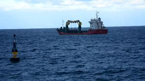 Tow boat in the middle of the sea stock video footage