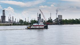 Tow boat traveling down river stock images