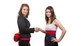 Tow business woman shaking hands. Stock Photos