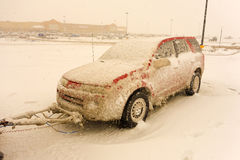 A tow car covered with snow in white-out conditions Royalty Free Stock Photography