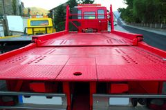 Tow car truck red rear view perspective platform royalty free stock image