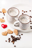 Tow cup of cappuccino with cookies as hearts Stock Photos