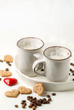 Tow cup of cappuccino with cookies as hearts Stock Photography