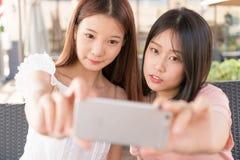 Tow girls making selfie stock photo