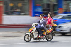 Tow grils riding on an e-bike, Shanghai, China Stock Photo