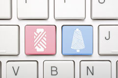 Tow kinds of thread on keyboard Royalty Free Stock Photo