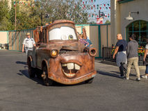 Tow Mater driving in Cars Land at in Disney California Adventure Park. ANAHEIM, CALIFORNIA - FEBRUARY 13: Tow Mater driving in Cars Land at in Disney California Royalty Free Stock Photo
