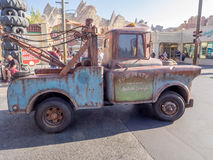 Tow Mater driving in Cars Land at in Disney California Adventure Park Stock Photo