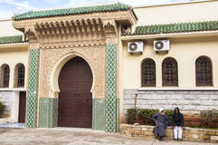 Tow men in front of Mosque in Meknes, Morocco Stock Photo