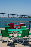Tow outdoor furniture sets. Red and green round tables with chairs Royalty Free Stock Photo