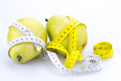 Tow pears and measuring tapes Royalty Free Stock Photos