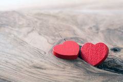 Tow red wooden hearts. On wood background stock photo