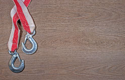 Tow rope for a car on wood background. Royalty Free Stock Photo