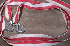 Tow rope for a car on wood background. Stock Photos