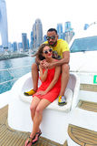 Happy Couple enjoy cruse trip at Dubai. Tow sweet couple enjoy honey moon at sea on yacht Royalty Free Stock Photos