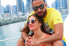 Happy Couple enjoy cruse trip at Dubai. Tow sweet couple enjoy honey moon at sea on yacht Stock Images