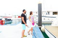 Man Surprice him lover. Tow sweet couple enjoy honey moon at sea on yacht Stock Image