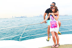 Man Surprice him lover. Tow sweet couple enjoy honey moon at sea on yacht Royalty Free Stock Photography