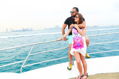 Man Surprice him lover. Tow sweet couple enjoy honey moon at sea on yacht Royalty Free Stock Images