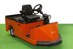 Tow tractor. Orange tug tow tractor for material handling stock image