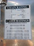Tow Truck, Chain Rating, Cable Ratings. Charts adhered inside a compartment door of a tow truck indicating chain ratings and cable ratings stock photo