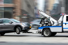 Tow truck delivers the damaged vehicle Stock Photography