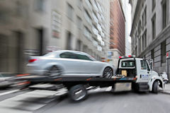 Tow truck delivers the damaged vehicle royalty free stock image