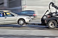 Tow truck delivers the damaged vehicle stock images