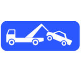 Tow truck lifting a car Stock Images
