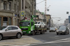 Tow truck `Moscow Parking` carries the car to the impound lot. Stock Photography