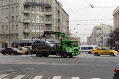 Tow truck `Moscow Parking` carries the car to the impound lot. Royalty Free Stock Image