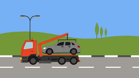 Tow truck picking up a car in town Royalty Free Stock Photography