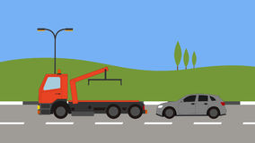 Tow truck picking up a car in town Stock Photos
