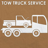 Tow truck service sign by old  paper Stock Photography