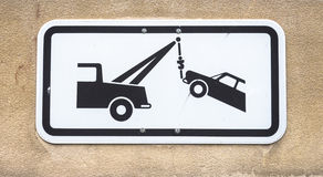 Tow truck. Sign at a no parking sign Stock Images