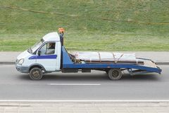 Tow truck with a small body in the city royalty free stock photos