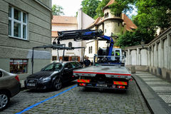 Tow truck from the street evacuated incorrectly parked car. Prague, Czech Republic - Juny 25, 2016: Tow truck from the street evacuated incorrectly parked car Royalty Free Stock Photography