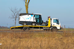 Tow truck and sweeper. Tow truck carries sweeper with repair Stock Photo