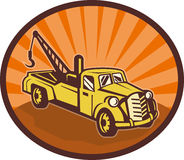 Tow truck wrecker pick-up truck Stock Photo