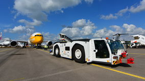 Tow tug pulling a Scoot Boeing 787 Dreamliner aircraft at Singapore Airshow Stock Image